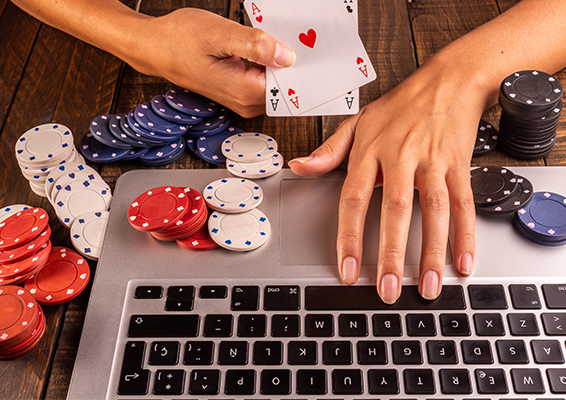 person playing casino on laptop